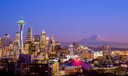 A scenic view of the Space Needle in Seattle, WA and the Mt. Rainier is visible in the background. This picture taken from Kerry Park, Queen Anne area on January 29, 2015 at 17:50.